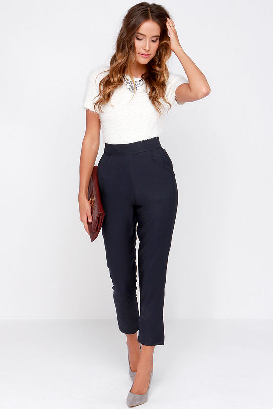 With white t-shirt, gray pumps and clutch