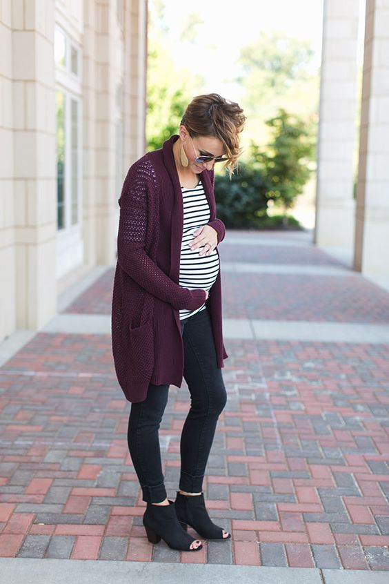 black jeans, black cutout boots, a striped shirt and a purple cardigan