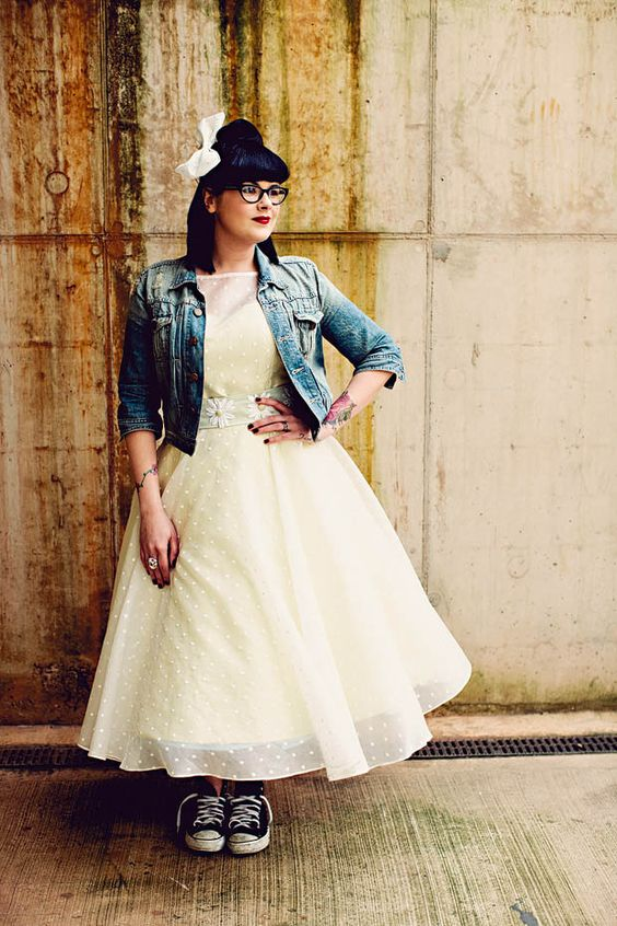 rock n roll bride in a tea-length dress, denim jacket and black Converse