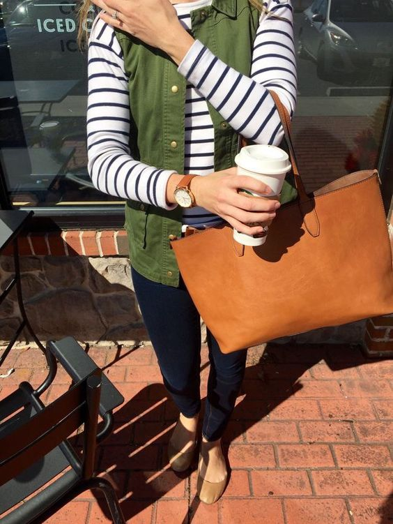 navy skinnies, a striped long-sleeve, an olive green vest and tan flats