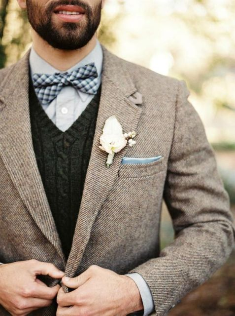 With plaid bow tie, knitted waistcoat and white flower boutonniere