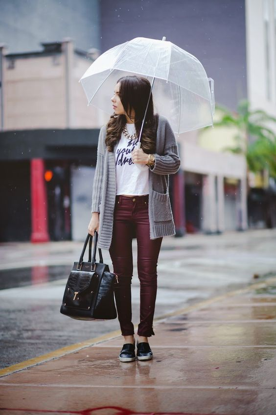 burgundy trousers, a printed tee, a grey cardigan and black slip-ons