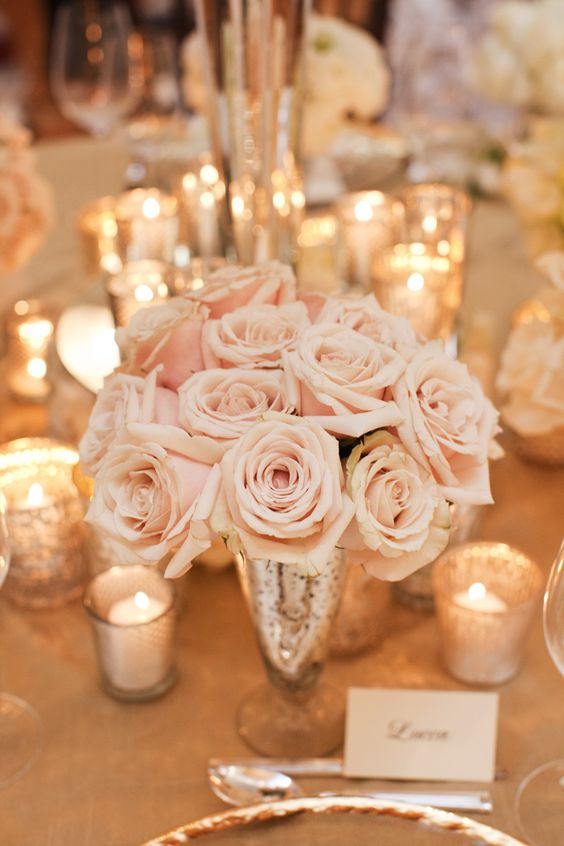 blush rose centerpiece in a gold vase