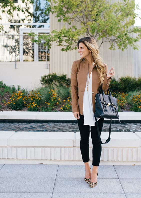 black cropped jeans, a white shirt, a tan jacket and leopard shoes