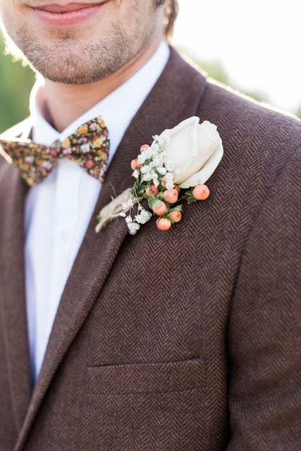 With floral bow tie and cute boutonniere