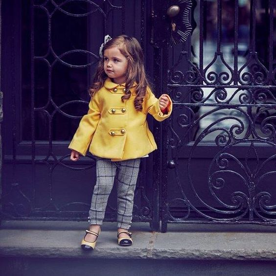 plaid grey trousers, a yellow coat, yellow and black shoes