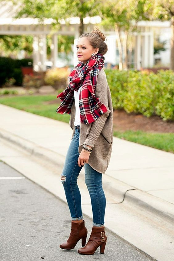 blue jeans, a white tee, an oversized brown cardigan and brown booties