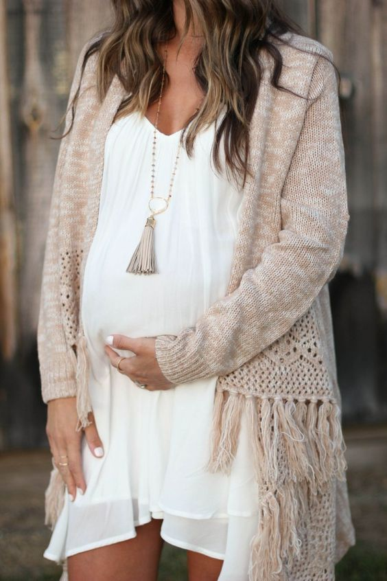 ruffled white dress, a comfy beige poncho with fringe