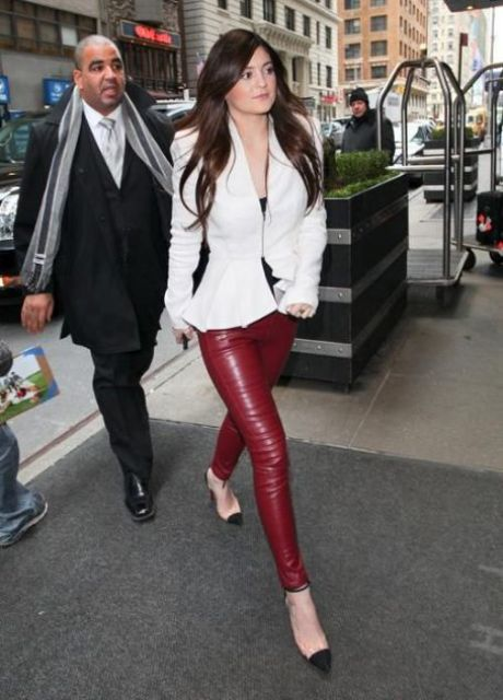 With leather pants and trendy shoes
