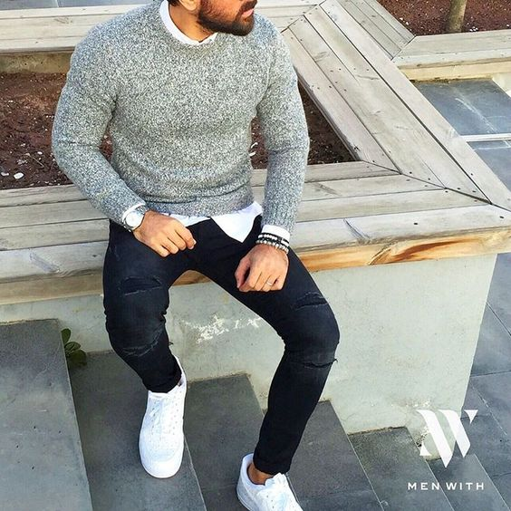 black ripped jeans, a grey sweater and a white shirt with white chucks