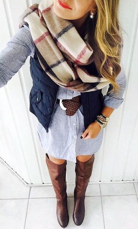 chambray button up dress, brown riding boots, navy vest, brown belt, and blanket scarf