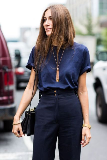 With dark blue t-shirt tassel necklace and bag