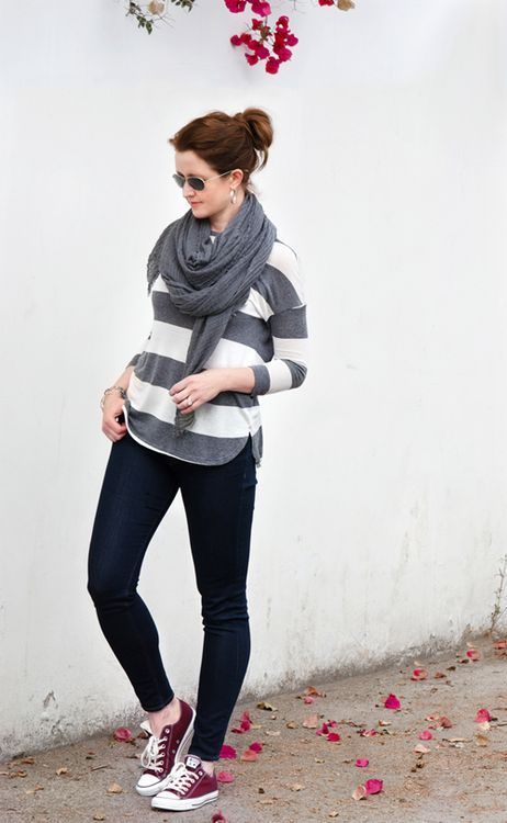 black jeans, a striped sweater, a grey scarf and oxblood Converse