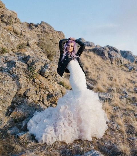 rock-n-roll bridal look with a mermaid dress, leather jacket and pastel hair