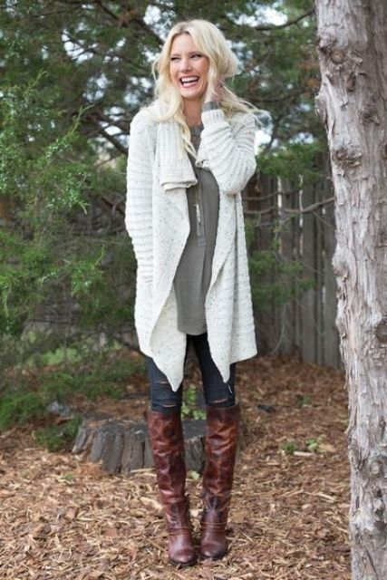 white chunky sweater cardigan, an olive green shirt and high boots