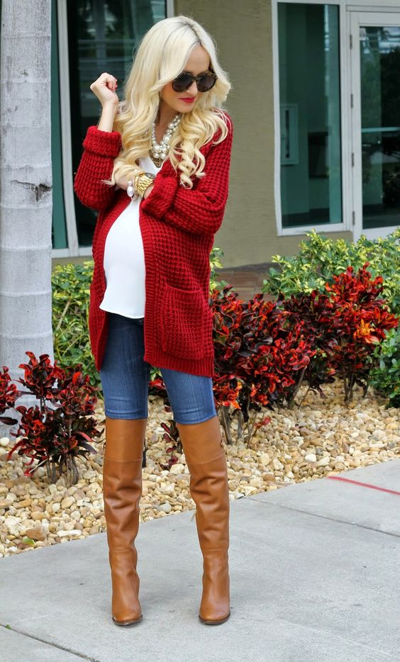 blue jeans, a white top, a long red cardigan and cognac high boots