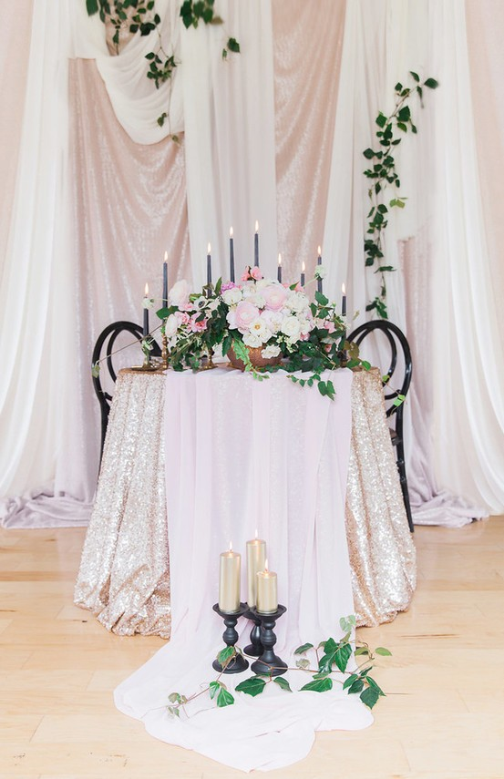 Sequin tablecloth with a blush runner looks very glam
