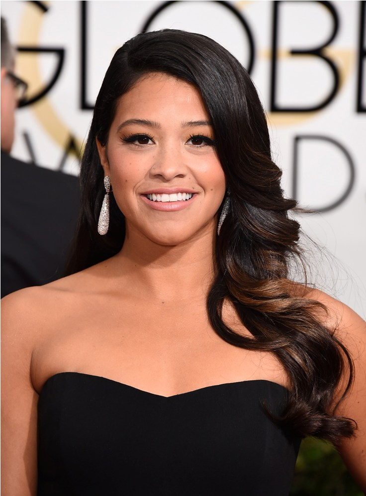 Gina Rodriguez arrives at the 72nd annual Golden Globe Awards at the Beverly Hilton Hotel on Sunday, Jan. 11, 2015, in Beverly Hills, Calif. (Photo by Jordan Strauss/Invision/AP)