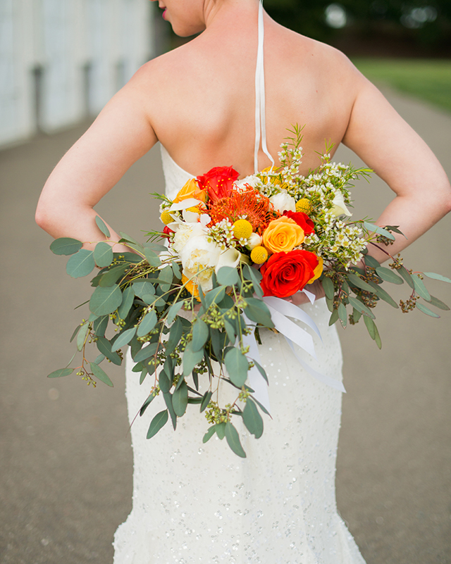 Bright orange and yellow bridal bouquet | Kelly Marie Photography
