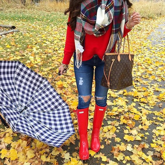 ripped denim, a red jersey, a plaid scarf and red rain boots