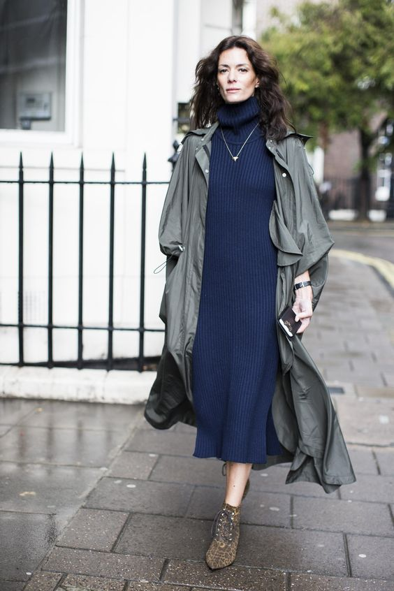 sweater dress, an olive green trench coat and animal-printed ankle boots