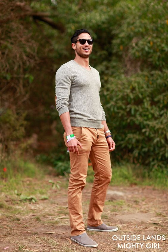 a grey sweater, ocher pants and brown shoes