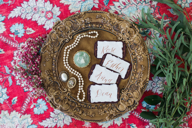 Gold calligraphy place cards   Molly Lichten Photography