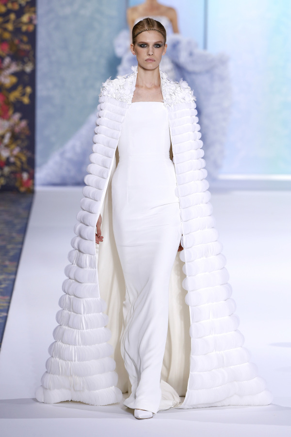 Ralph&Russo features a minimalist strapless dress with a fur coat