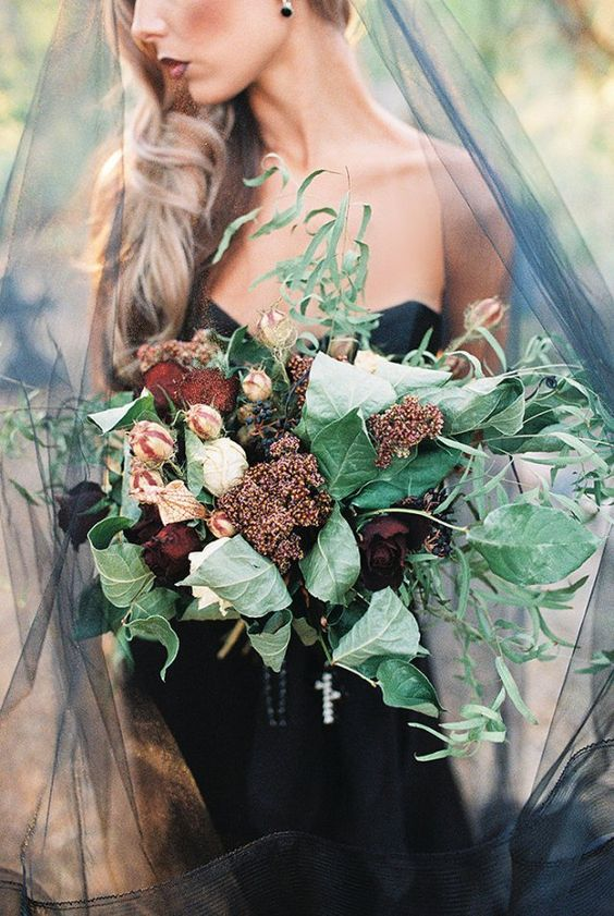 moody bridal bouquet with large green leaves