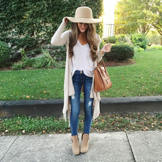 blue jeans, a white blouse, a long nude cardigan and nude ankle booties