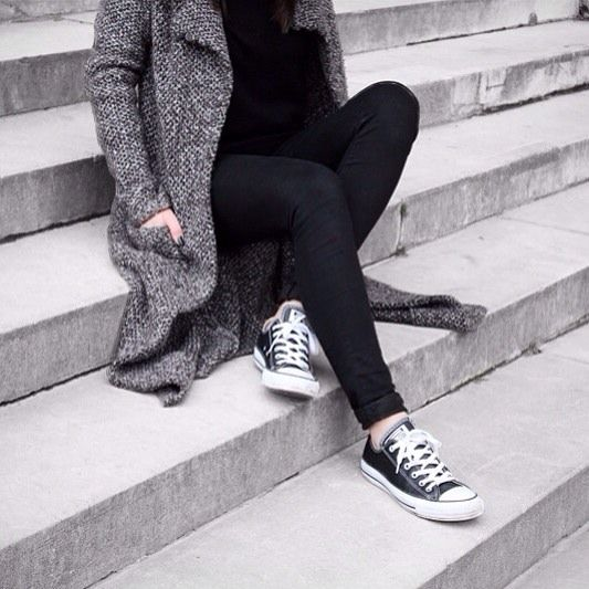black jeans, a black sweater and a grey cardigan