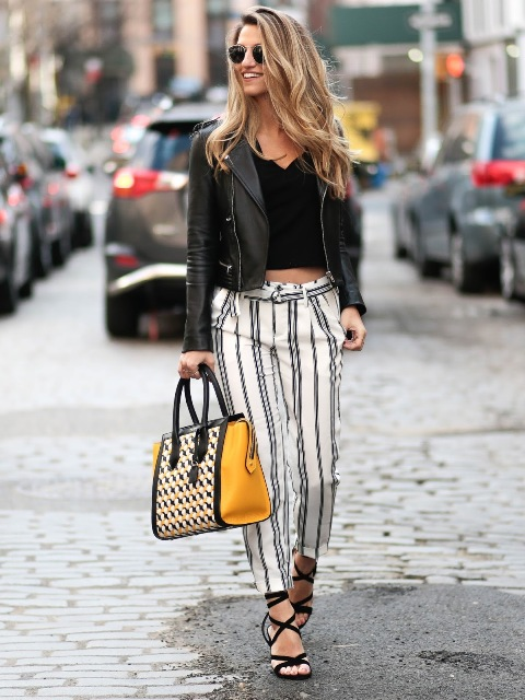With leather jacket, crop top and lace up heels