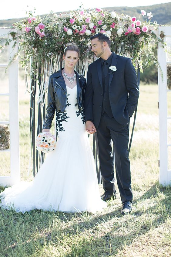 black lace detail strapless gown with tulle skirt and a leather jacket