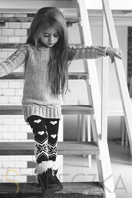 printed leggings, a sweater and fur boots