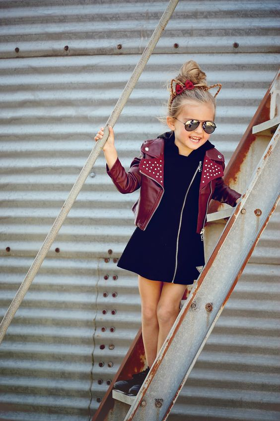 black zip dress, a red leather jacket and black sneakers