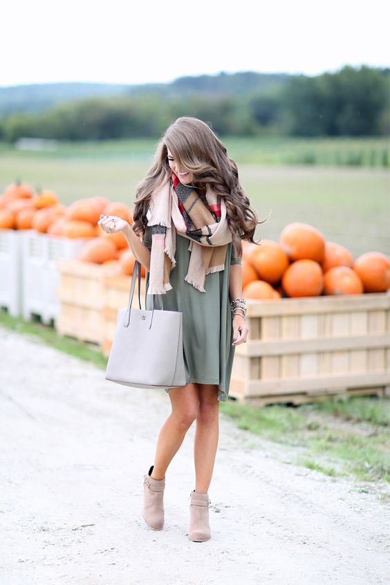 olive green swing dress, a checked scarf and ankle booties
