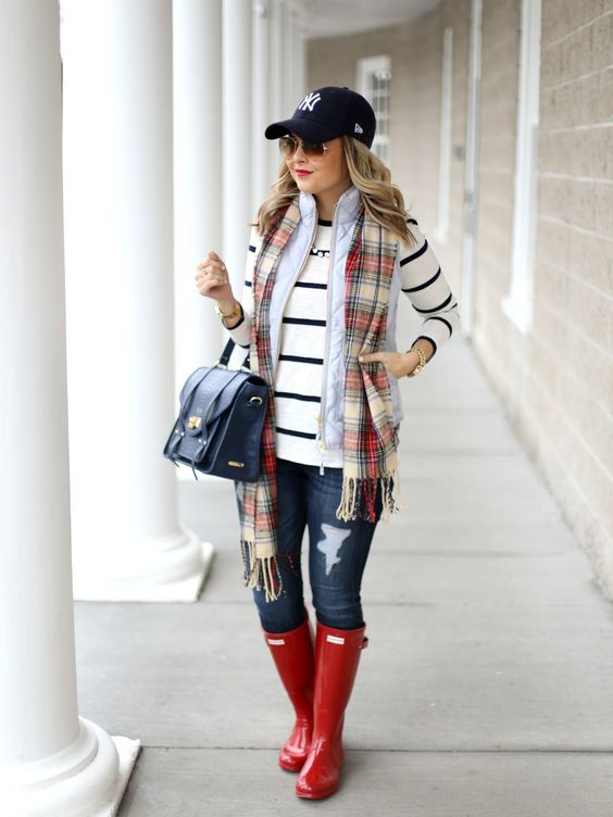jeans, a striped jersey, a plaid scarf, a quilted vest and red rain boots