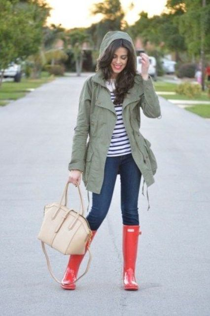 jeans, a striped tee, an olive green jacket and red rain boots