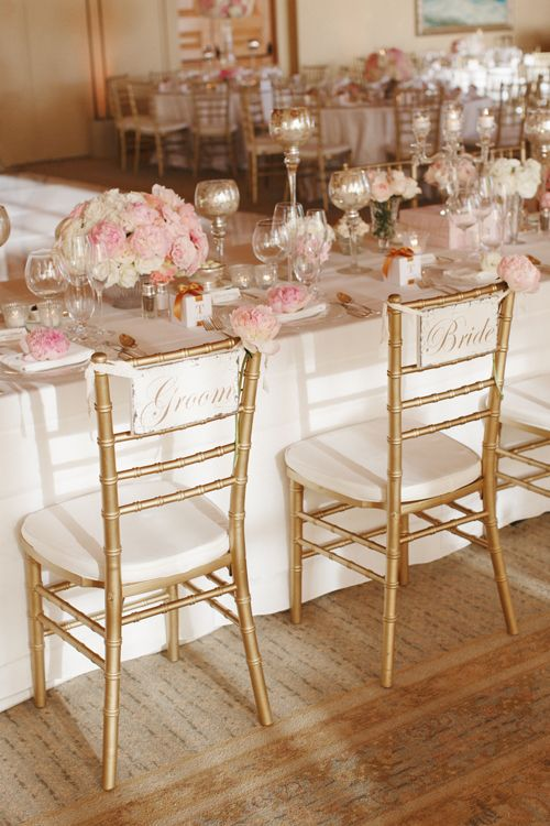 blush table decor and gold chairs
