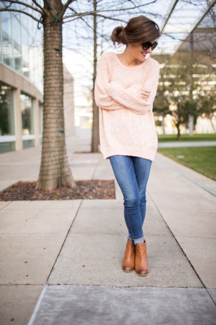 With oversized pullover and skinny jeans