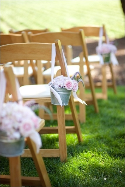 With gentle roses along the aisle