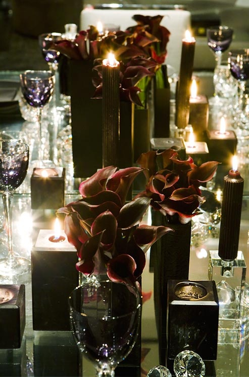 black candles and dark purple callas for table decor