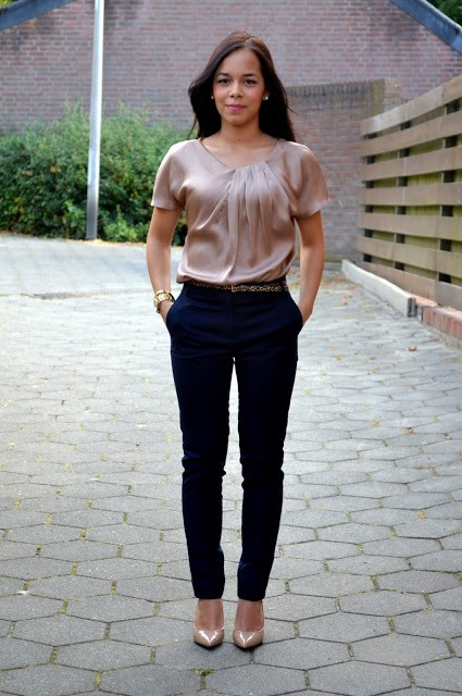 With silk pink blouse and neutral shoes