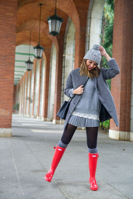 grey pleated dress, a grey coat, leg warmers