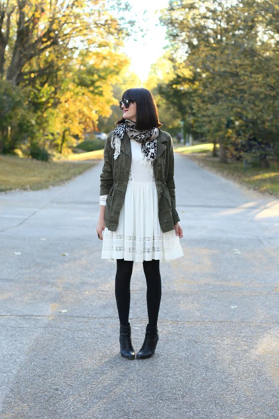 a cream dress for fall, army jacket, black tights