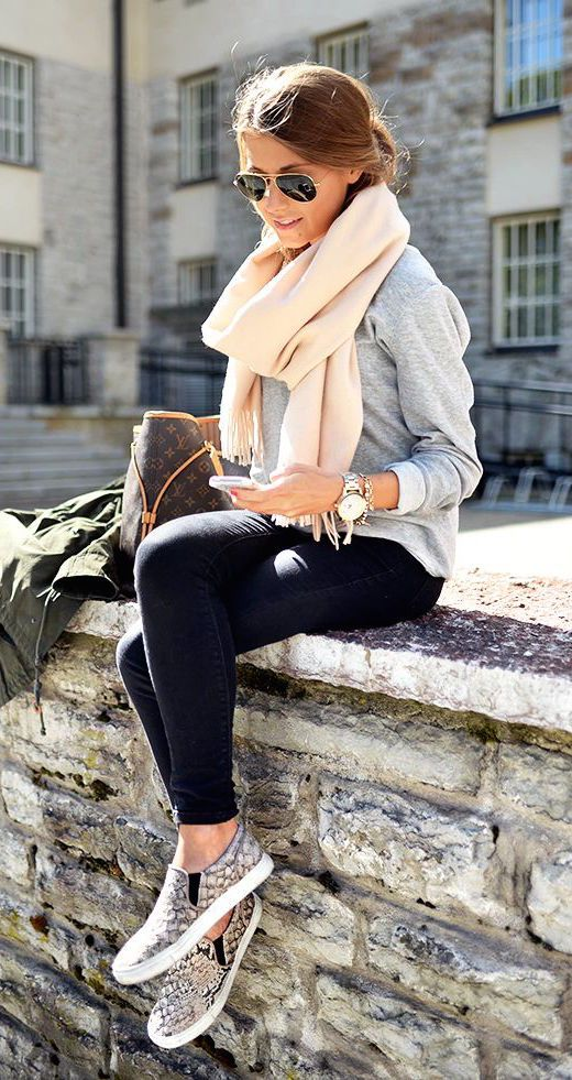cream scarf, a grey knit, black jeans and animal printed loafers