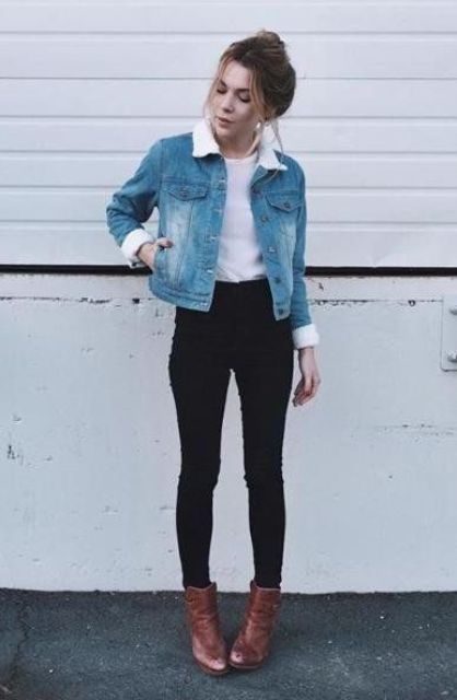 black jeans, a white top, brown ankle boots and a denim jacket