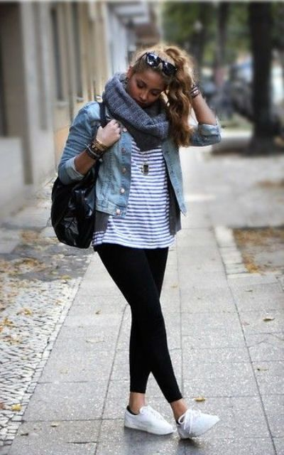black leggings, a striped tee, a denim jacket and white sneakers