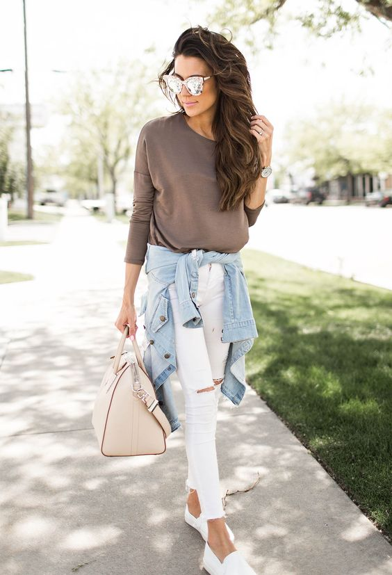 taupe top, white ripped jeans, white slip-ons and a blue jacket