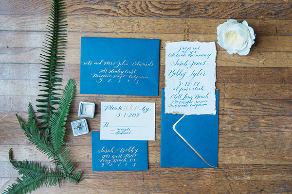 blue wedding invitations - photo by Jillian Rose Photography http://ruffledblog.com/romantic-wedding-ideas-with-pops-of-jewel-tones
